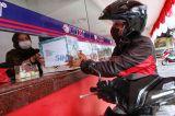 Layanan Tiki Drive Thru Jadi Pilihan di Tengah Pandemi