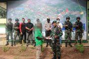 Warga Papua Serahkan Senjata Api dan Amunisi ke Satgas Yonif 411/Pdw