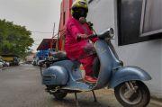 Peringati Hari Kartini, Rucke Mabu Pakai Kebaya Naik Vespa Bagikan 1.000 Masker