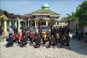 Puluhan Pendekar PSHT Rayon Krikilan Masaran Salurkan Ribuan Masker