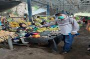 Dinas Perdagangan OKI Bagikan Masker untuk Pedagang Pasar