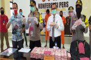 29.600 Lembar Uang Palsu Pecahan Rp100.000 Disita Polisi saat Razia