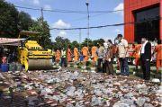 Polres Bogor Musnahkan Ribuan Botol Miras dan Bongkar Prostitusi Panti Pijat