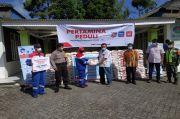 Peduli Covid-19, Pertamina Salurkan CSR Kepada Warga di Dua Desa di Karo