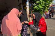 PSBB Transisi di DKI Diperpanjang, PSI Bagikan Masker di Pasar