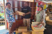 Kadis Kominfo Jayapura Sumbang Ribuan Buku untuk Rumah Baca Kampung Yoboi