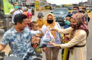 Anggota DPR RI Renny Astuti Bagikan 1 Ton Ikan ke Warga Sumsel