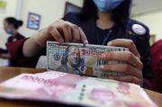 Proyeksi IMF dan Penolakan UU Ciptaker Bikin Rupiah Tak Bergairah