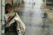 Foto Viral Mengubah Nasib Pemulung Muda