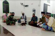 Marinir Serahkan Kitab Suci Alquran untuk Masjid dan Pesantren di Pulau Sebatik