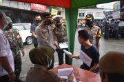 Polres Bogor Jaring 55 Pelanggar PPKM Stasioner di Babakanmadang