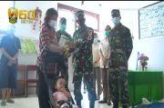 TNI AD Bantu Pengobatan Korban Bencana Banjir di Manado