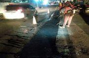 Tambal Sulam Jalan Berlubang di Jalan Protokol Jakarta Selatan