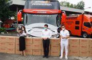 Peringati 1 Tahun Covid di Indonesia, KosmeMask Bagikan Masker 1 Bus