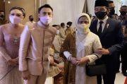 Tas Kulit Hitam yang Lengkapi Penampilan Iriana Jokowi di Nikahan Atta-Aurel