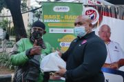 Baja Perindo Bagikan Makanan, Masker, dan Face Shield untuk Pengguna Jalan di Kebon Sirih