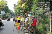 Bantu Mobilitas Pejalan Kaki, Pemkot Jaktim Bangun Trotoar di Jalan Munjul
