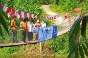 Setahun Lebih Rusak, GIS Bantu Perbaiki Jembatan Gantung Karang Bolong
