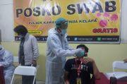 Pulang Mudik, Belasan Warga Jalani Test Covid-19 di Polsek Kembangan