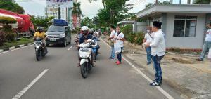 Bagi-bagi Nasi Kotak ke Pengguna Jalan, Ketua Perindo Jambi Tetap Terapkan Prokes