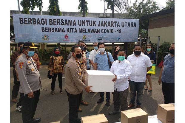 Polres Jakut Distribusikan 1.000 Paket Sembako dan Ikan Segar untuk Masyarakat