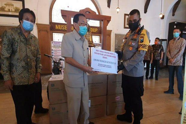 Maspion Group Sumbang 100.000 Masker Medis ke Polrestabes Surabaya