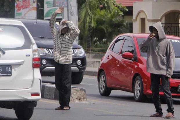 Tangsel, Kota Seribu Pak Ogah