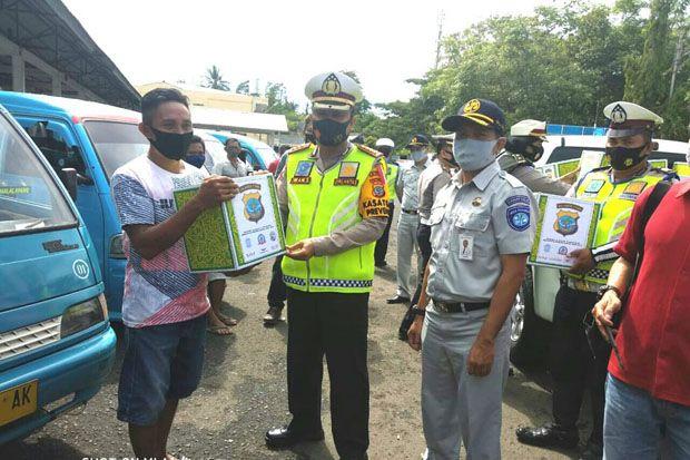 2000 Paket Sembako Dibagikan di Empat Titik di Manado