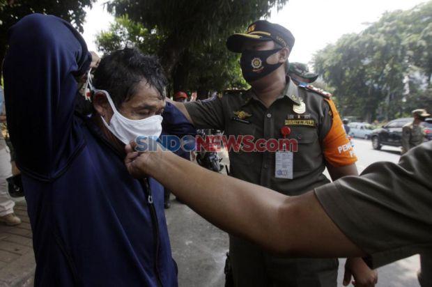 Sepanjang 12-24 Oktober Tren Memakai Masker dan Jaga Jarak di Jakarta Menurun