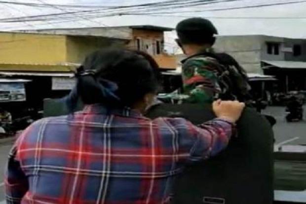 Kodam Jaya Ungkap Identitas Perempuan Naik Ranpur TNI saat Penertiban Baliho Habib Rizieq
