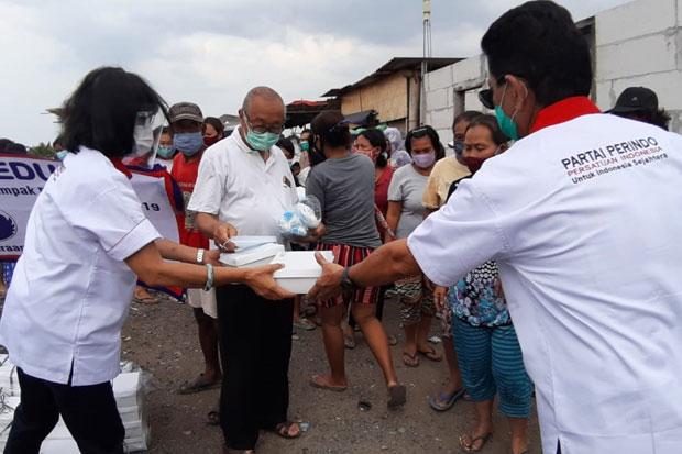 Partai Perindo Salurkan Bantuan untuk Warga Pemulung di Jakarta Utara