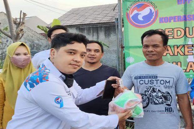 Berbagi Kebaikan, DPP Pemuda Perindo Bagikan 300 Paket Sembako di Bekasi