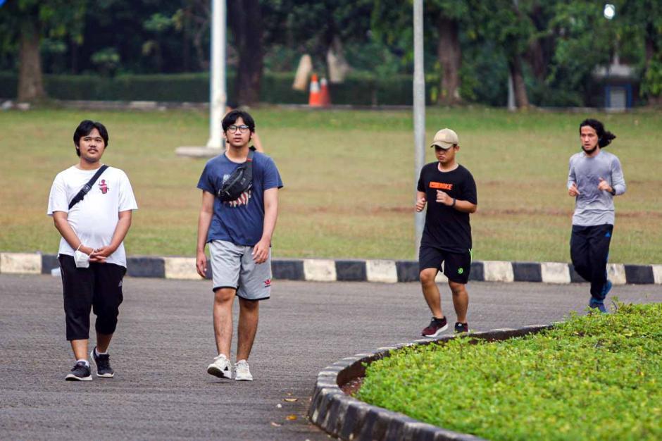 Warga Manfaatkan Area Universitas Indonesia untuk Berolahraga-0